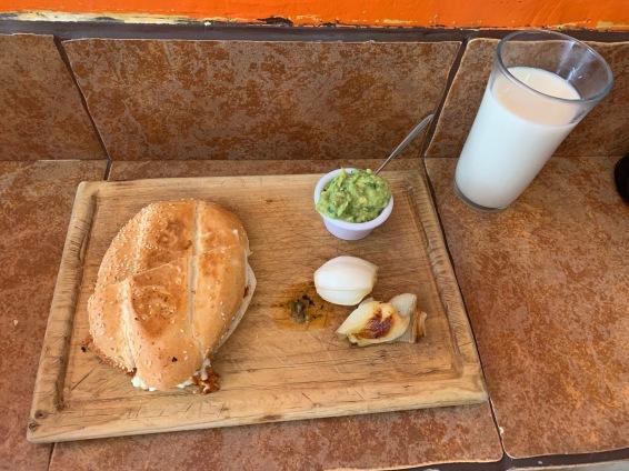 Chorizo sandwich with shallot, guacamole, and horchata