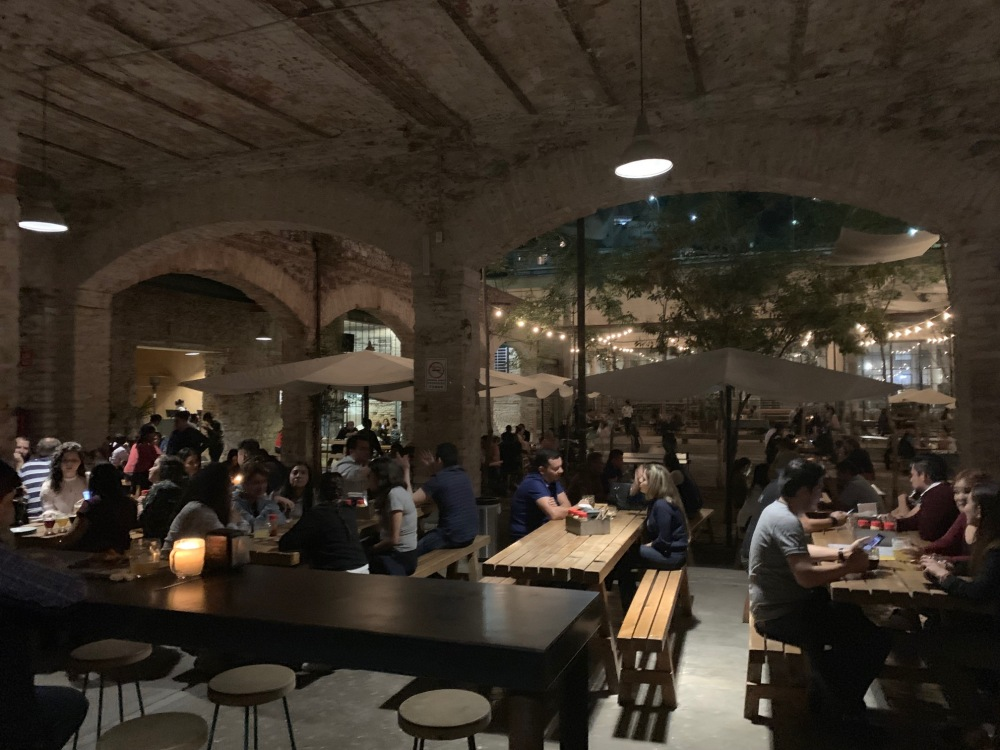 Beer garden inside Cerveceria Hercules, located in a former factory