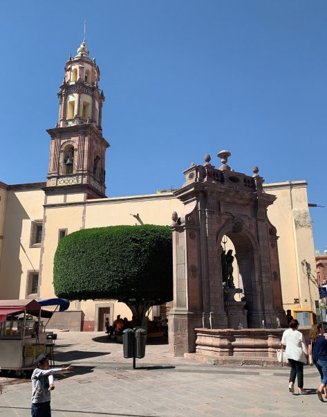 Neptune's Fountain and the Sacred Heart Church