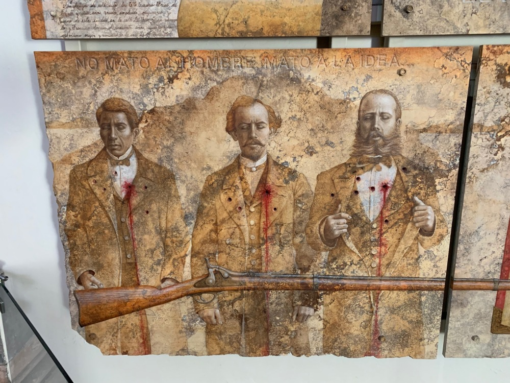 Mural of three figures of the Mexican revolution who were shot for treason, located in the Casa de la Corregidora