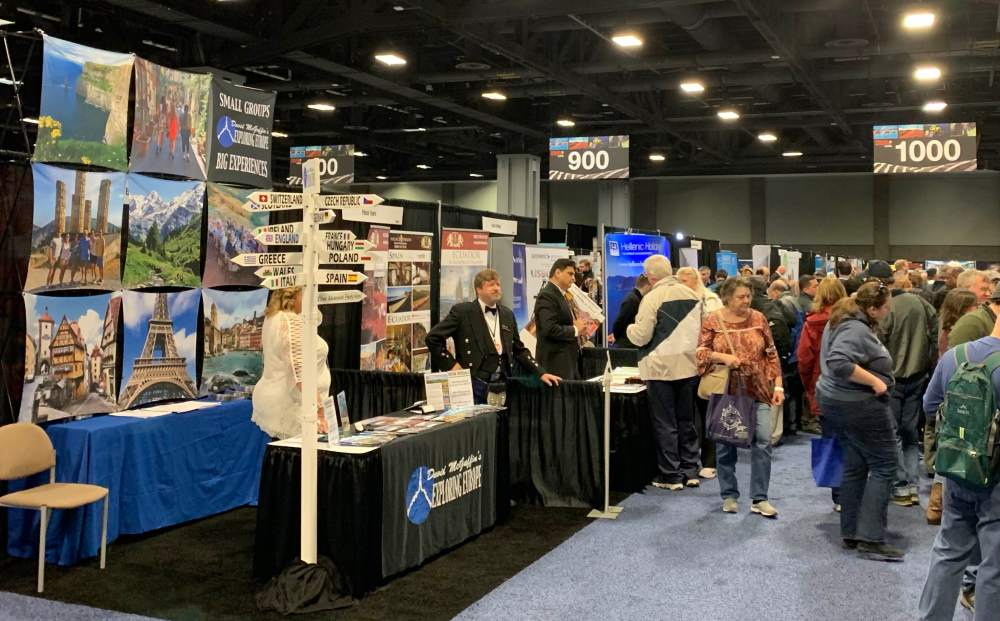 Scene from the exhibit hall showing people visiting booths