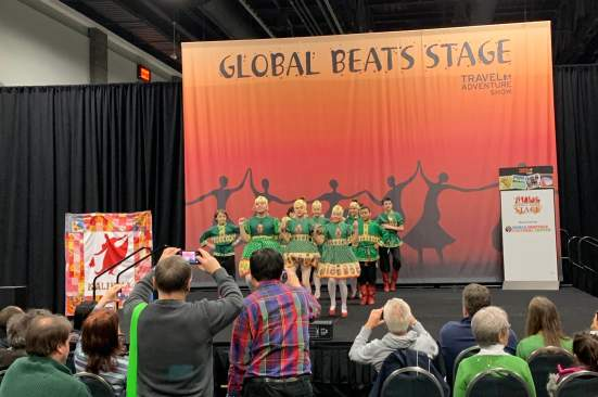 Dancers perform the kalinka dance from Russia on the Global Beats Stage at the DC Travel & Adventure Show