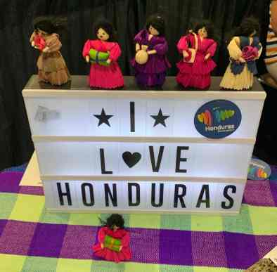 I Love Honduras display with little dolls at the Honduras tourism booth in the exhibit hall