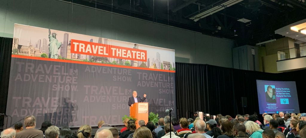 Peter Greenberg speaking at the Travel Theater at the DC Travel & Adventure Show