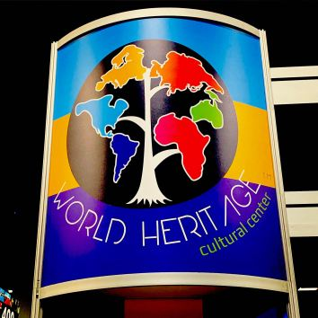 World Heritage Cultural Center logo with continents sprouting out of a tree like branches