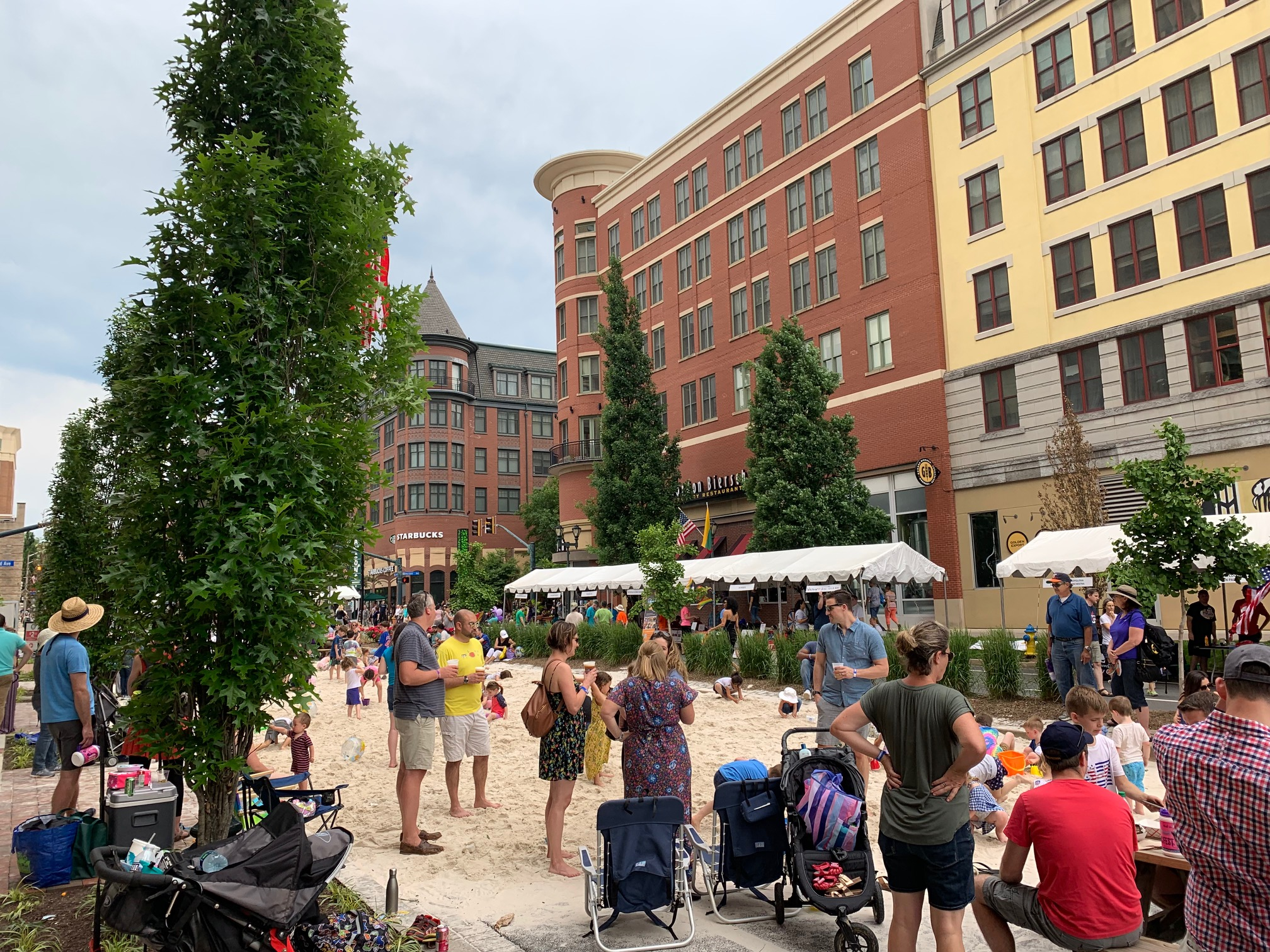 "Sand on Middle Lane as a ""beach"" for kids to play on at HomeTown Holidays in Rockville, Maryland. The event, which is held annually, was May 25-26, 2019."