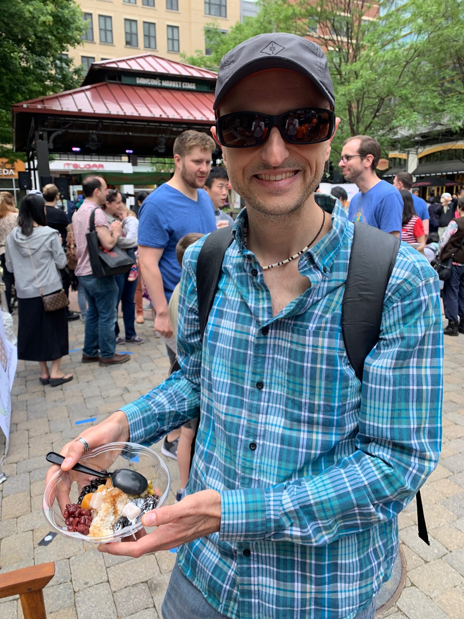 The author holding a bowl of frozen dessert (containing beans, taro, fruit and ice) at the Taiwan Bubble Tea Festival in Rockville, Maryland. The festival was May 11, 2019.