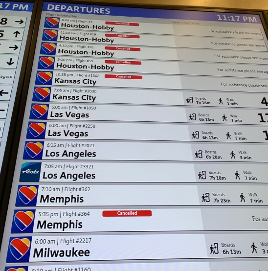 Flight board at Dallas Love Field showing several cancelled flights, mine included
