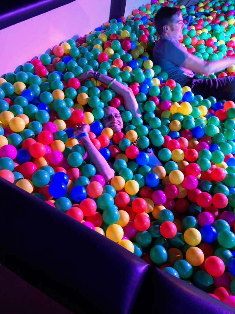 Me playing in the plastic ball pit at the closing party