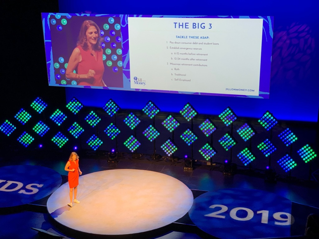 "World Domination Summit 2019 Keynote Jill Schlesinger presents the ""Big 3"" things that people should address first with their money: 1. pay down debt and loans, 2. establish emergency reserves; and 3. maximize retirement contributions"