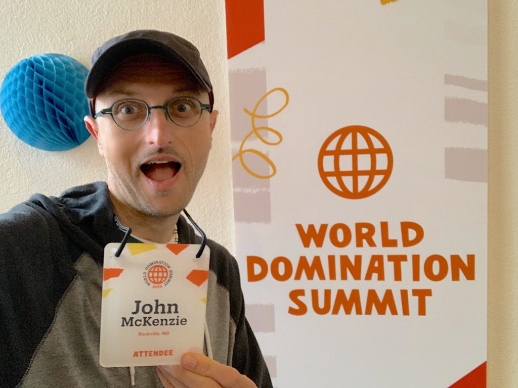 Me posing at the registration headquarters for World Domination Summit 2019