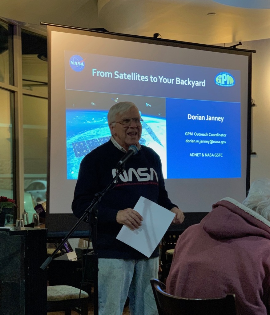 "Rockville Science Cafe moderator introducing the evening's presentation ""From Satellites to Your Backyard"" and NASA speaker, our friend Dorian Janney (not pictured)"