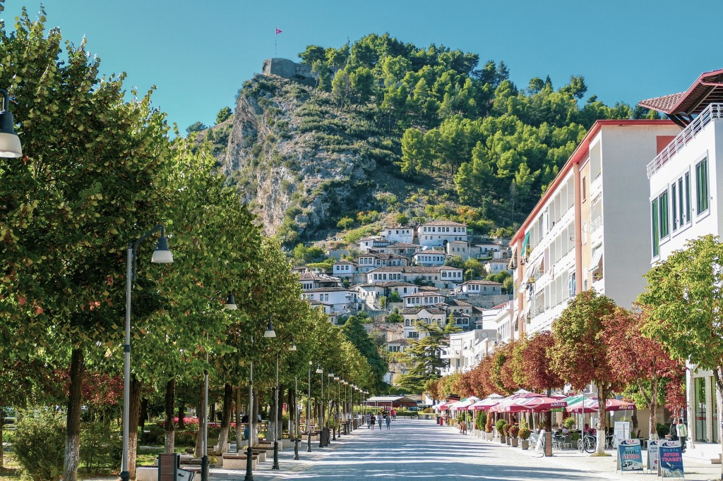 Main street of Berat with hilltop fortress and houses in background