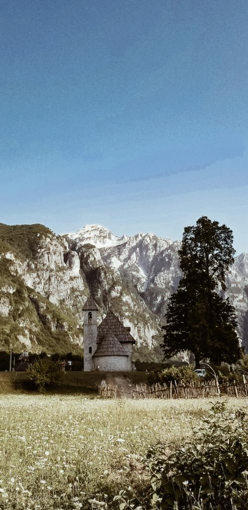 Village church with backdrop of snowcapped mountains