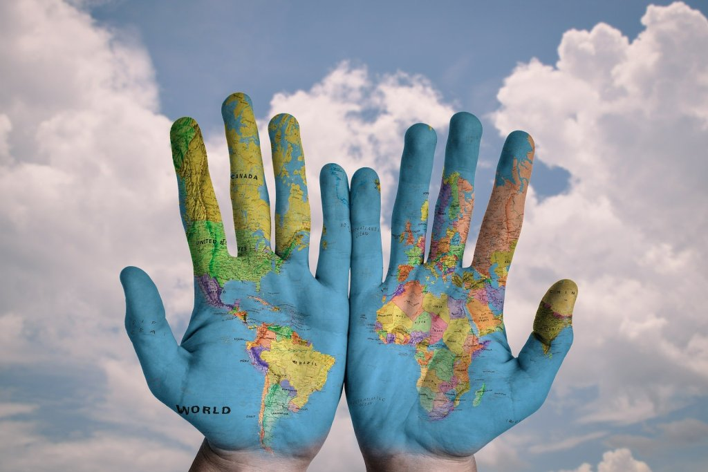 Two hands with map image superimposed