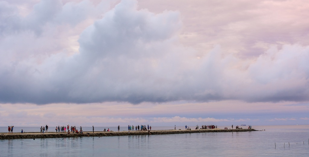 Periwinkle-tinted clouds over a pier somewhere in Tonga